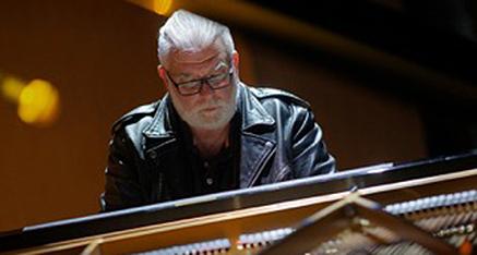 Ratko Delorko playing piano