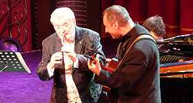 Sir James Galway and Sam Piha performing live on stage